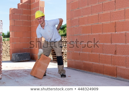 shots of bricklayer at work in construction site stock photo © photography33