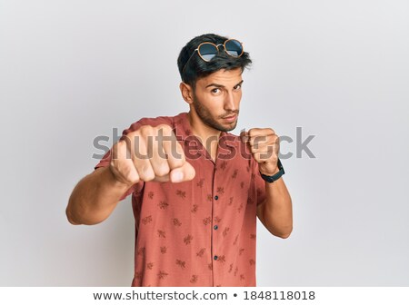 Portrait of young man with clenched fist Stock photo © Massonforstock