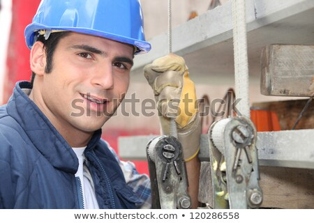 kereskedő · emel · építkezés · munka · háttér · kék - stock fotó © photography33