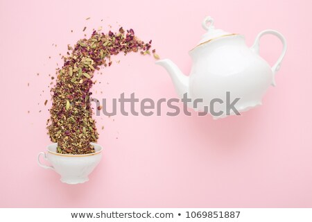 fresh tea from porcelain tea kettle into green cup Stock photo © shutswis