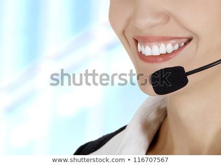 Call center woman with headset against abstract background Stock photo © Nobilior