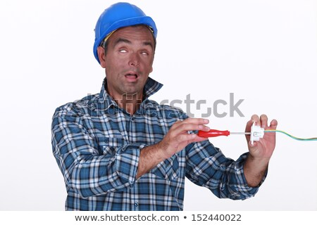 Tradesman suffering from electric shock Stock photo © photography33