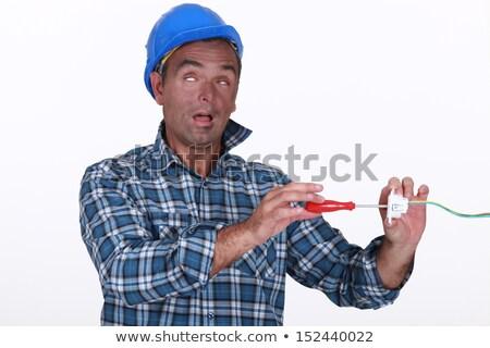 Kereskedő szenvedés elektromos rázkódás arc kalap Stock fotó © photography33