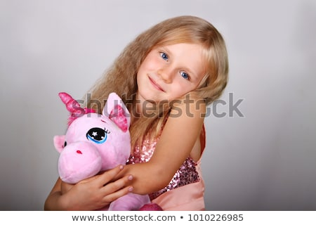 Pretty girl in a pink dress with plush toys Stock photo © acidgrey
