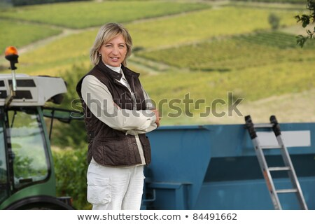45 years old woman in front of a tractor and vines Stock photo © photography33