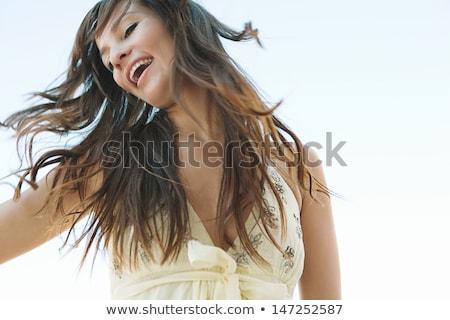 Jovem bela mulher dança blue sky mulher sorrir Foto stock © rosipro
