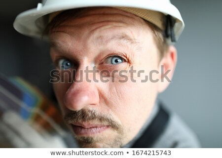 A suspicious construction worker Stock photo © photography33