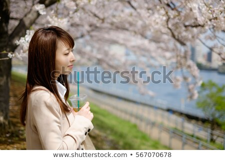Stare. Outdoors portrait of  Beautiful woman in pink blossoms on Stock photo © Victoria_Andreas