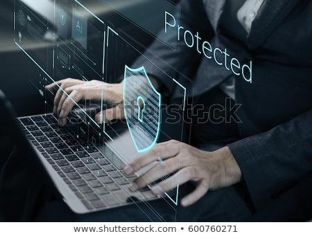 számítógép · biztonság · kézifegyver · lövedékek · vmi · mellett · laptop · számítógép - stock fotó © eldadcarin