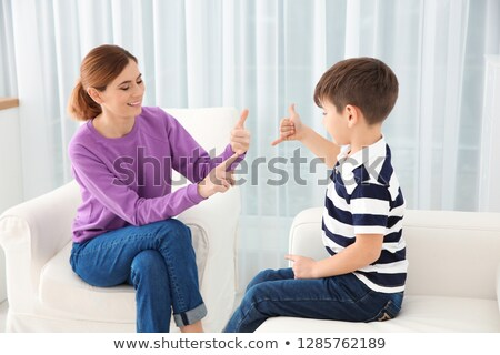 happy mother talking to her son at home stock photo © hasloo