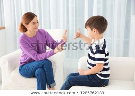 Heureux mère parler fils maison femme Photo stock © HASLOO