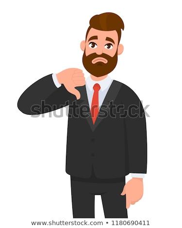 férfi · mutat · hüvelykujjak · lefelé · közelkép · portré - stock fotó © dolgachov
