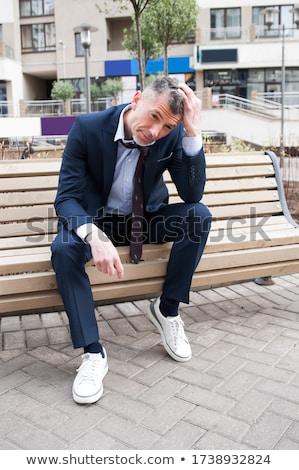 Işadamı oturma bank baş ağrısı park iş Stok fotoğraf © jakubzak