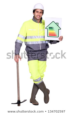 handsome heating engineer with hand resting on pickaxe Stock photo © photography33