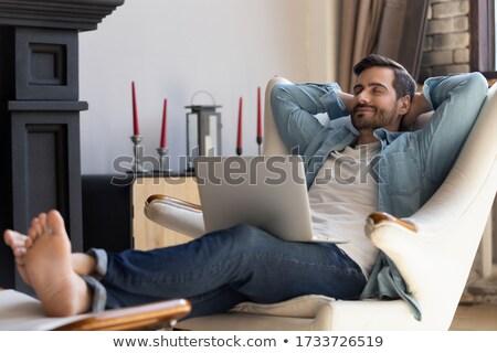 happy relaxing sitting man Stock photo © meinzahn