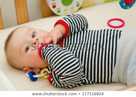 baby lying on his back with toy stock photo © gewoldi