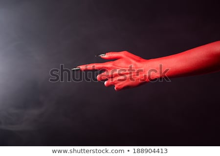 Red Devil Pointing Hand With Black Sharp Nails Extreme Body Art Stock fotó © Elisanth