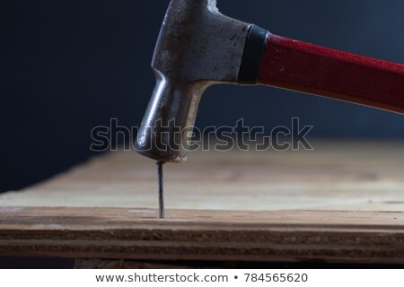 Hammer and nails on wood plank stock photo © ambientideas