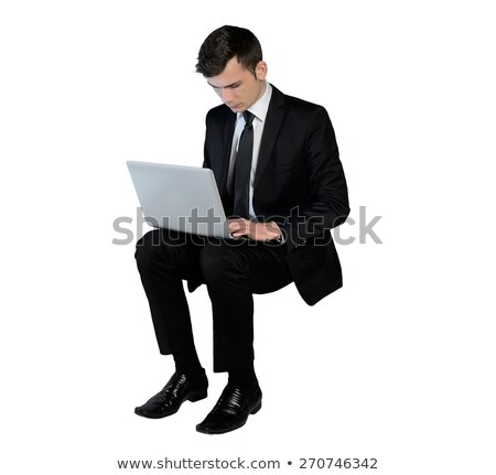 happy young business man sitting down and smile  Stock photo © feedough