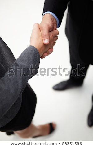 detail businessman and woman shaking hands stock photo © monkey_business