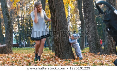 Woman playing hide and seek with her son Stock photo © bmonteny