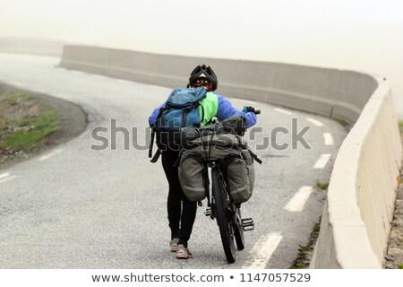 mulher · empurrando · bicicleta · para · cima · colina · grama - foto stock © przemekklos