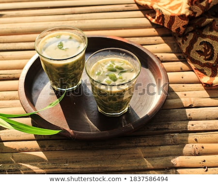 iced herb drinks serving on wood table stock photo © nalinratphi