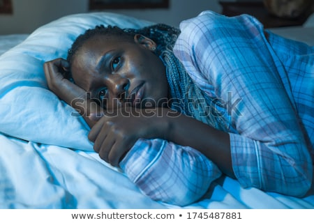 Young woman lying awake in bed Stock photo © dash