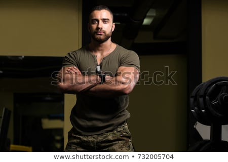 Biceps shot of a strong man Stock photo © jiri_miklo