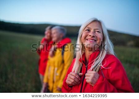 Nő vörös haj portré virágok mosoly szépség Stock fotó © meinzahn