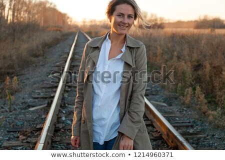 Girl with suitcase walking down a path outdoors. happiness. stock photo © Ainat