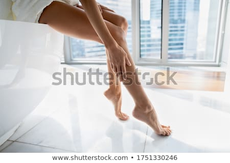 close up of young woman sitting in bath towel stock photo © dolgachov