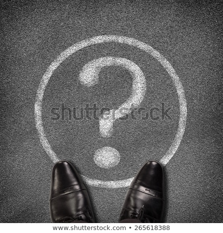 shoes standing on asphalt road with circle and question mark stock photo © cherezoff