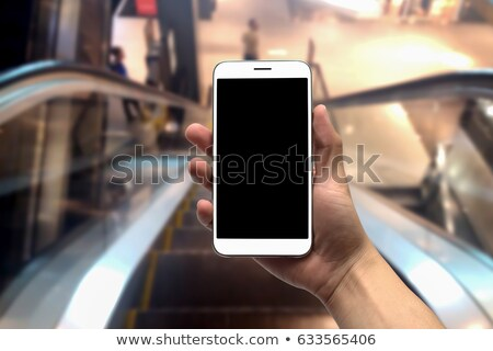 blurred abstract background of people on oving escalators stock photo © stevanovicigor