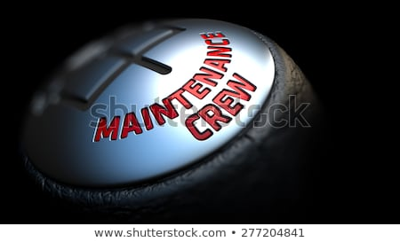 Onderhoud crew zwarte versnelling Rood tekst Stockfoto © tashatuvango