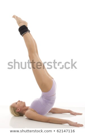 Portrait of a young caucasian woman does gymnastics with ankle weights Stock photo © ambro