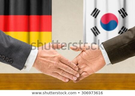 Alemanha Coréia do Sul apertar a mão mão reunião assinar Foto stock © Zerbor