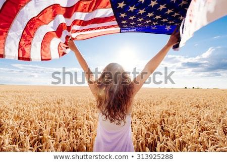 Amerykańską flagę dziewczyna piękna uśmiechnięty gwiazdki niebieski Zdjęcia stock © keeweeboy