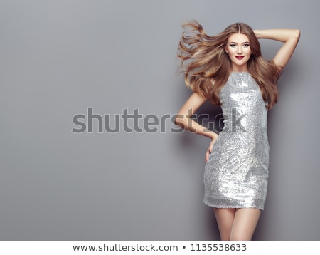 Stock fotó: Nő · pózol · szürke · ruha · stúdió · portré