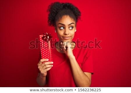 Kız bakıyor hediye güzel bir kadın kırmızı hediye kutusu Stok fotoğraf © dnsphotography