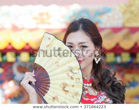 538ed42ca Mulher ventilador moda sensual dança retrato Foto stock © Elnur · Mulher  dança vestido vermelho isolado branco sensual