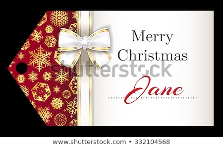 Luxury Christmas name tag with golden snowflakes and white ribbon Stock photo © liliwhite