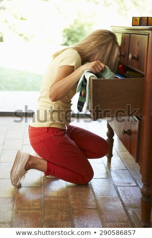 Woman searching for clothes in chest of drawers Stock photo © deandrobot