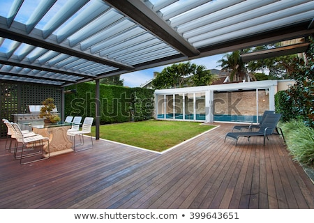 A beautiful outside view  of house  with wooden floor and garden stock photo © jrstock
