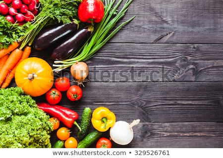 Background of wooden  black planks with fresh vegetables. Stock photo © rrvachov