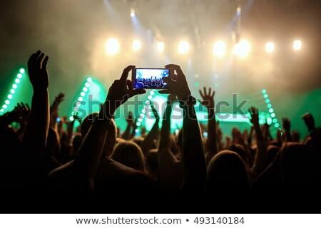Rock concert crowd recording performance with digital tablet Stock photo © stevanovicigor