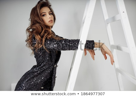 Photo adorable brunette femme robe noire Photo stock © majdansky