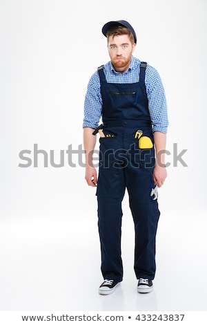 Full length of funny tired reapairman in overall and cap Stock photo © deandrobot