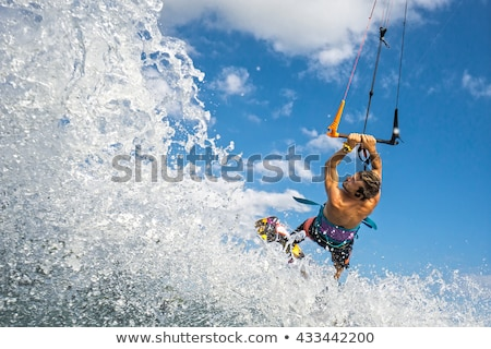 extreme kite surfer on beautiful waves stock photo © morrbyte
