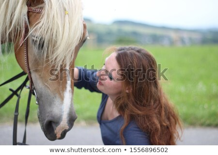 Stock photo: Attratcive lady relaxing with her horse friend